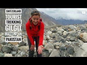 Swiss couple. Tourists from Switzerland trekking at Gulkin glacier to ...