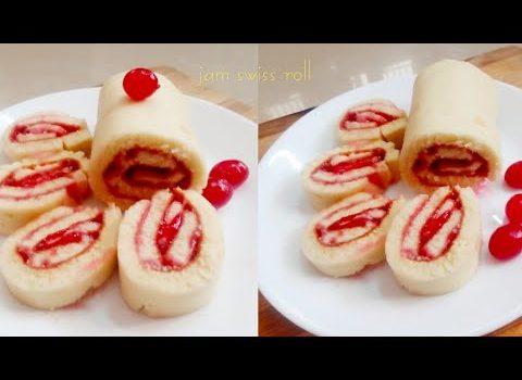 Jam Swiss roll. Bakery style Swiss roll. Swiss roll on pan.